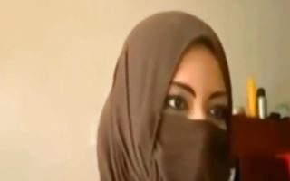 Hot Arabic lady is staring into the camera spreading her pussy lips