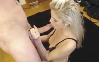 She is wearing sexy lingerie in the garage and is blowing his cock