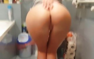 Hot ginger babe in the bathroom blowing his giant dick in the bathroom