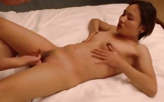 Asian cutie naked on the bed gets fingered and pussy fucked rough