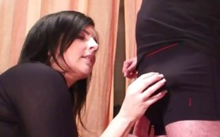 Brunette chick on her knees blowing fat donger