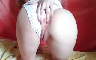 Teen babe fucking her shaved cunt with a black dildo