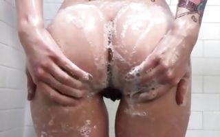 Wet babe is in the shower exposing her round boobs and booty