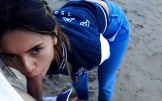 Beach blowjob with a crazy teen exposing her boobs