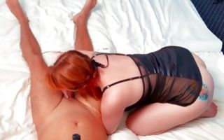 Red-haired bitch gives her boyfriend a blowjob