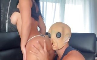 Nasty dude wearing a mask fucking her face