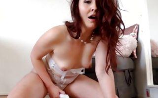 Brunette babe wearing while lingerie and she masturbates