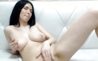 Brunette hottie with big seductive boobs performing solo