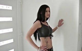 Naughty brunette in leather biker dress gets fucked hard