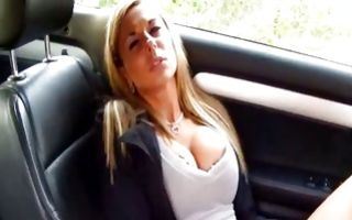 Big tits girlfriend enjoying fingering cunt in a pink car