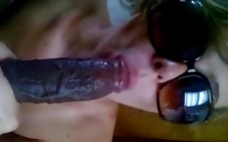 Naughty brunette in glasses sucks a dildo in homemade porn
