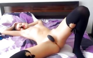 Bitch in long socks enjoys masturbation with toys