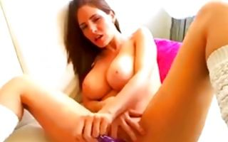 Brunette fucks her huge dildo with amazing boobs naked