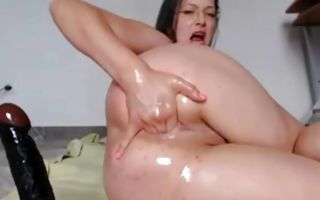 Nasty wench gets wet during hard solo asshole drilling